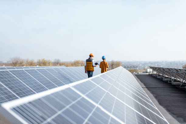 Engineers on a solar power plant stock photo