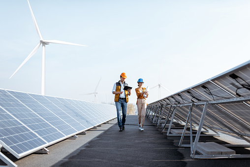 Engineers On A Solar Power Plant Stock Photo - Download Image Now