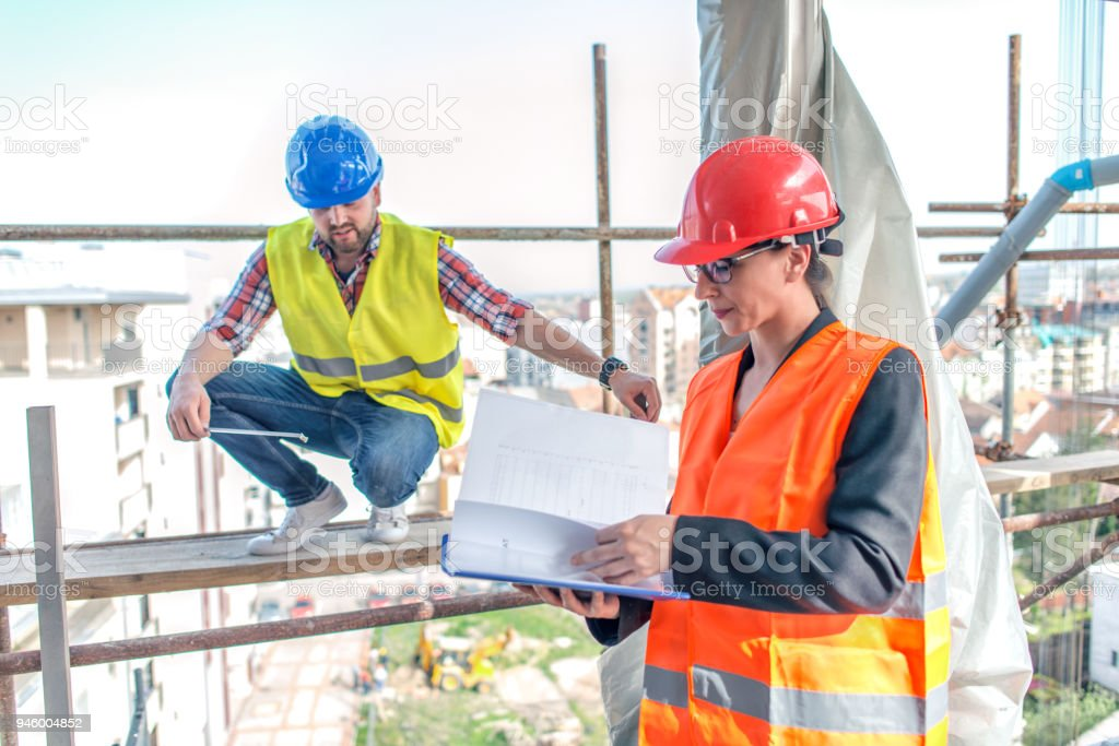 Engineers on construction site stock photo more pictures of adult blueprint building activity construction industry construction site discussion malvernweather Image collections