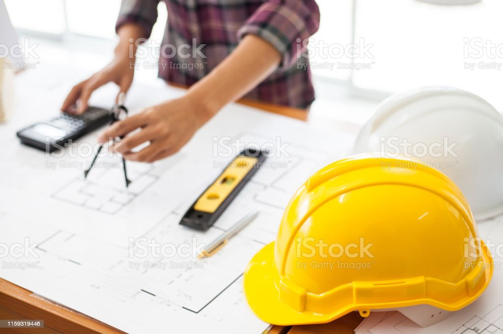 Construction and building concept. Engineers or architect using a...