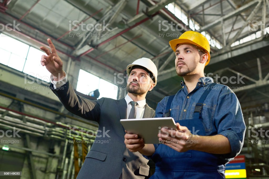Engineers Planning at Factory royalty-free stock photo