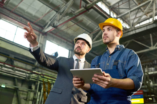 engineers planning at factory - factory stock photos and pictures