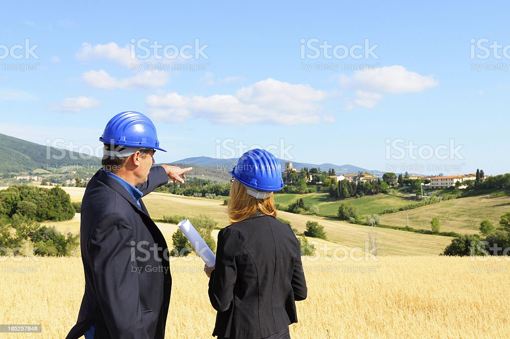 Engineers Planning in the Countrysidewith stock photo
