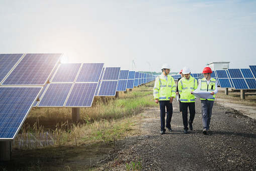 Asian engineers survey at green energy base