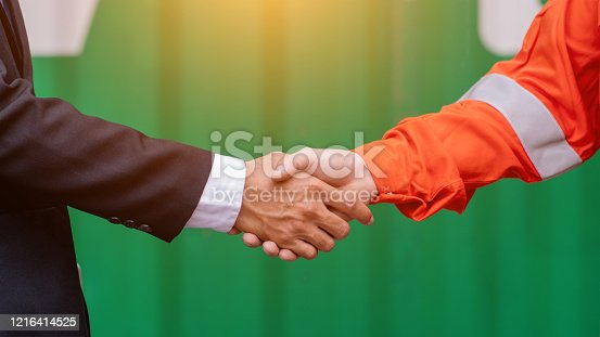 976560476 istock photo Engineers shake hands with businessman. 1216414525