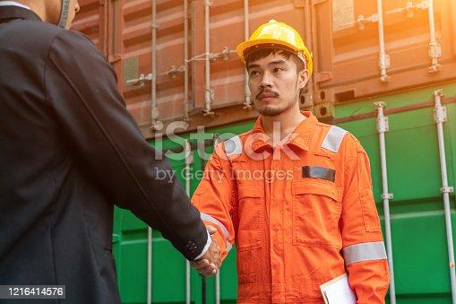 976560476 istock photo Engineers shake hands with businessman. 1216414576