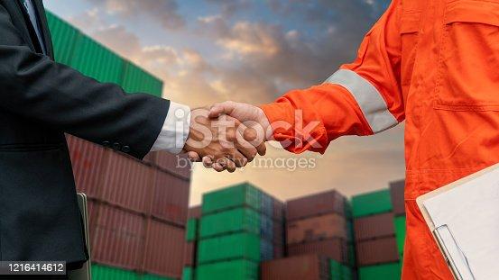 976560476 istock photo Engineers shake hands with businessman. 1216414612