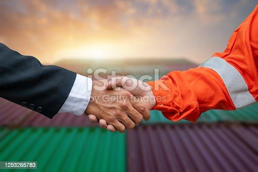976560476 istock photo Engineers shake hands with businessman. 1253265783