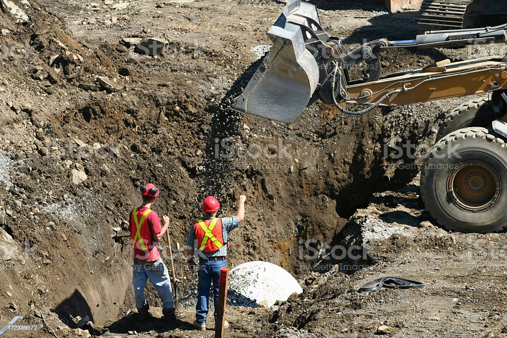 Engineers signaling a bulldozer operator royalty-free stock photo