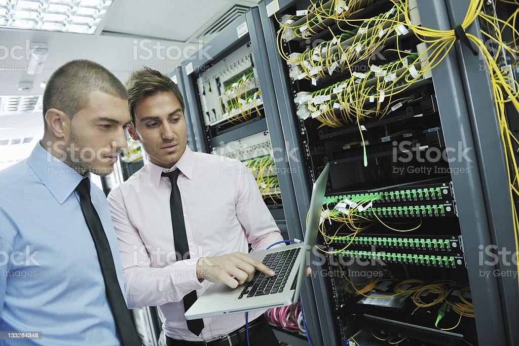IT engineers solving problems in network server stock photo