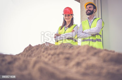643843490 istock photo Engineers standing at the construction site 593321638