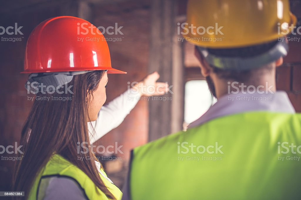 Engineers working on built structure stock photo