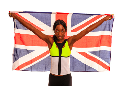British athlete with the British national flag. Celebrating her victory.