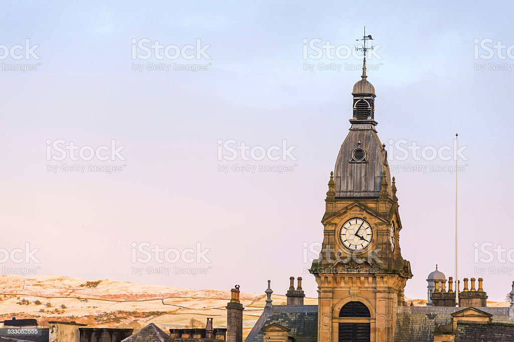 England: Kendal Town Hall and roof tops in wintry light stock photo