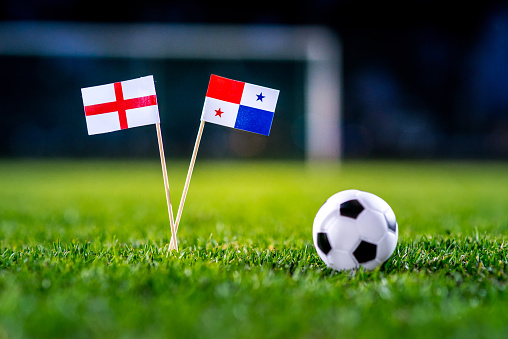 England - Panama, Group G, Sunday, 24. June, Football, World Cup, Russia 2018, National Flags on green grass, white football ball on ground.