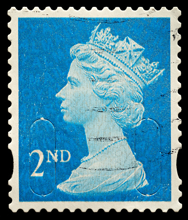 Exeter, United Kingdom - November 21, 2010: English Used Second Class Postage Stamp showing Portrait of Queen Elizabeth 2nd, printed and issued in 2010