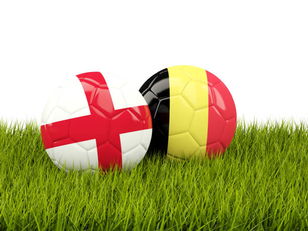England vs Belgium. Soccer concept. Footballs with flags on green grass stock photo