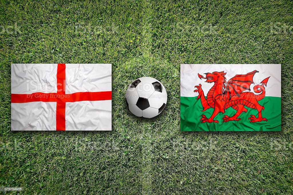 England vs. Wales flags on soccer field stock photo