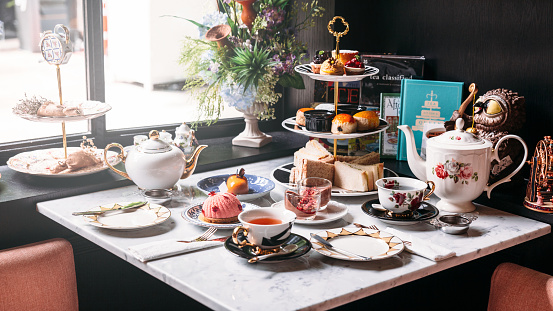 English Afternoon Tea Set Including Hot Tea Pastry Scones Sandwiches And Mini Pies On Marble Top Table Stock Photo - Download Image Now