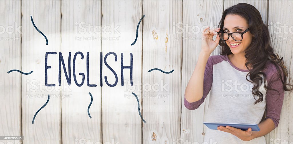 English against pretty brunette using a tablet pc stock photo