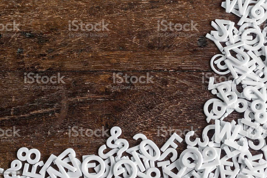 English alphabet background with space on wood texture stock photo