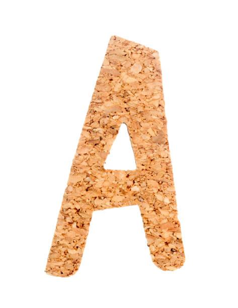 englische alphabet aus kork auf weißem hintergrund. - schöne englische wörter stock-fotos und bilder