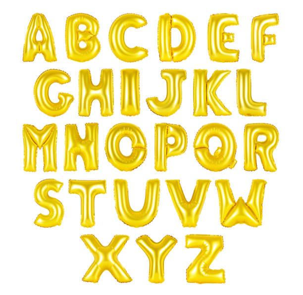 English alphabet golden color stock photo