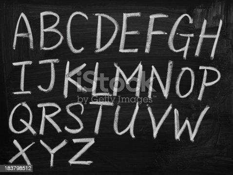 Twenty six letters of English alphabet on blackboard.