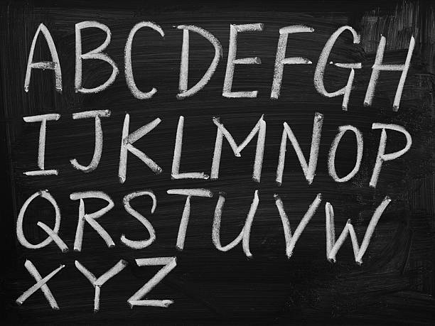 english alphabet on blackboard - alphabet stock pictures, royalty-free photos & images