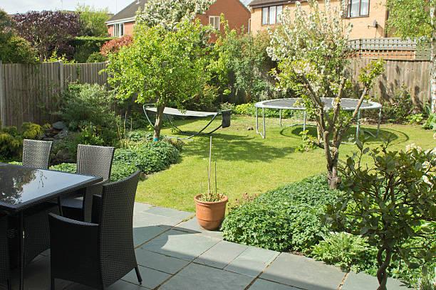 english back garden - gartentrampolin stock-fotos und bilder