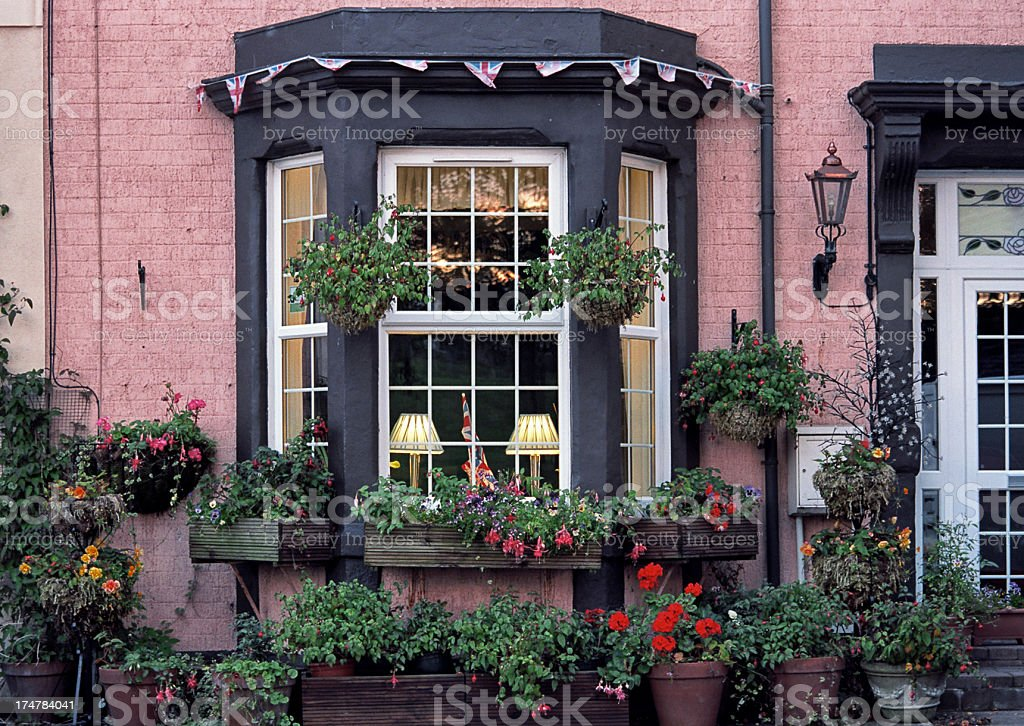 English bay window with plenty of flower pots stock photo for Fenetre meaning in english