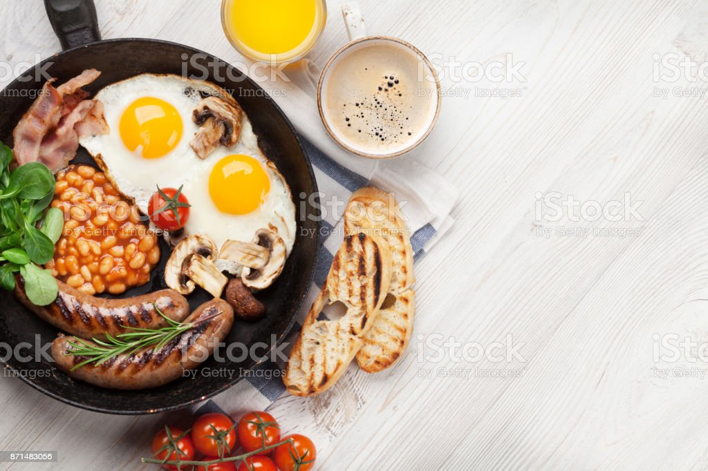 English breakfast. Fried eggs, sausages, bacon stock photo