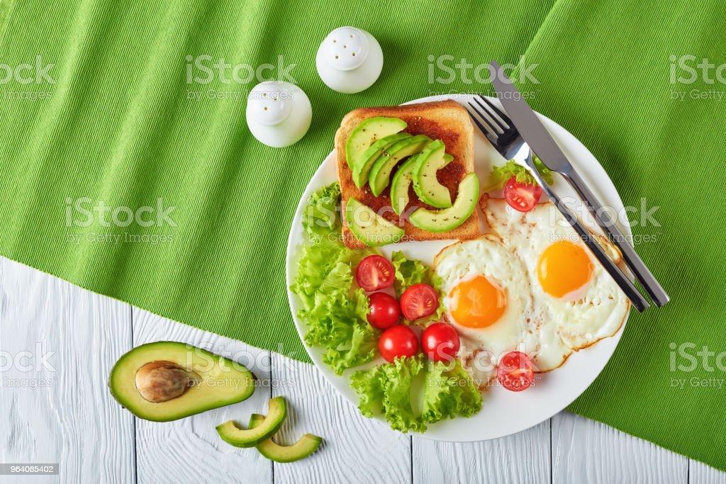 english breakfast - fried eggs, toast, salad - Royalty-free Above Stock Photo