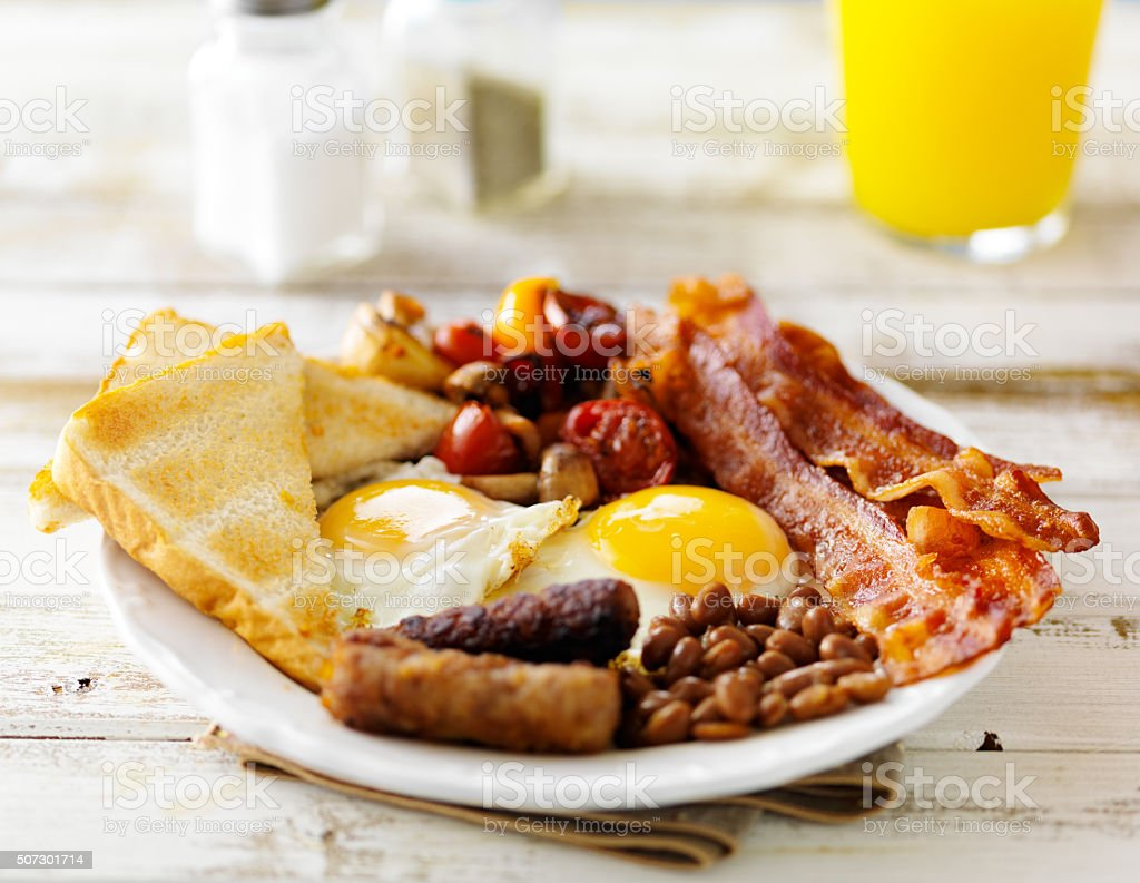 english breakfast on white rustic table stock photo