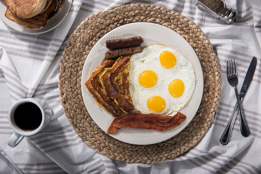 Sandwich egg with fruit salad VS Sunny side up egg with sausage, bacon and French toast (Click for more)