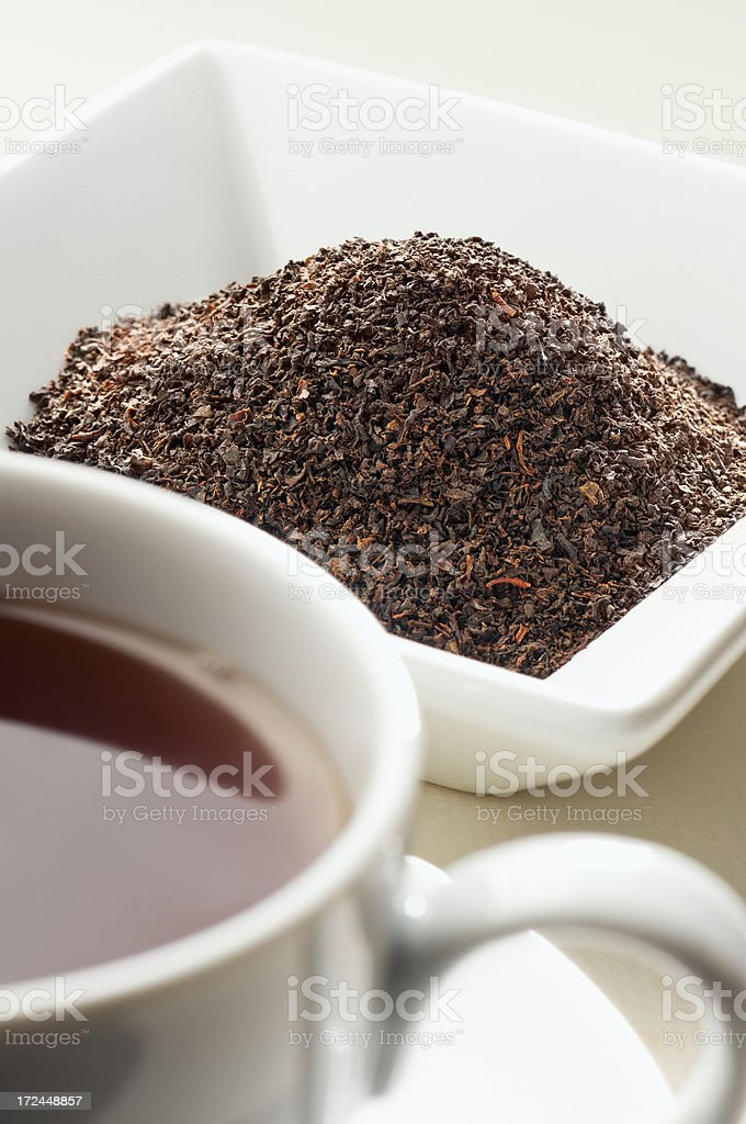 English breakfast tea leaves behind cup of tea royalty-free stock photo