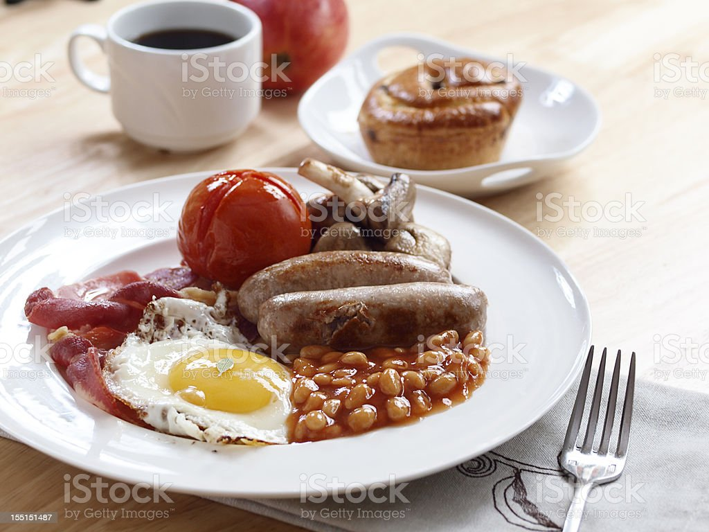 English breakfast with a cup of coffee and baked good stock photo