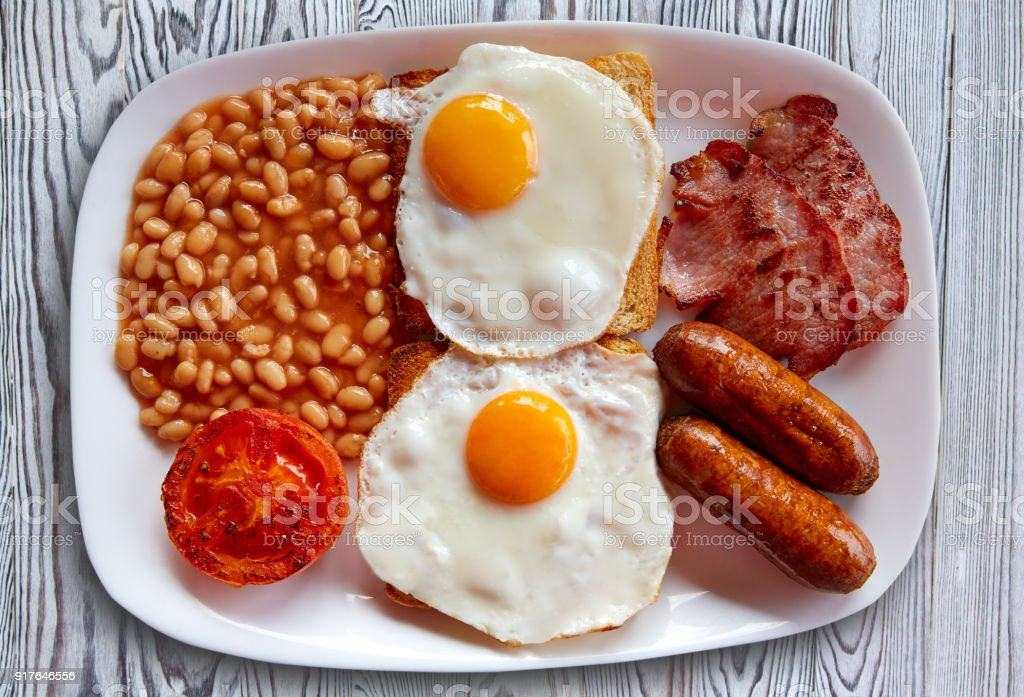English breakfast with two eggs sausage beans stock photo