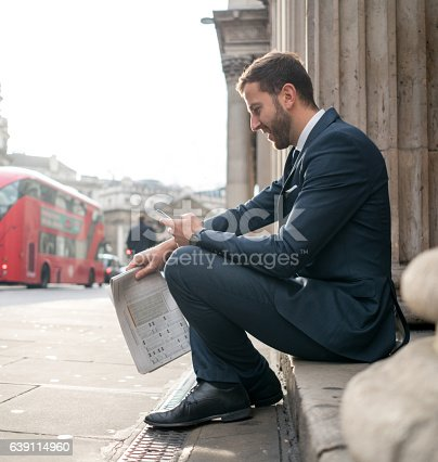 istock English business man using his phone on the street 639114960