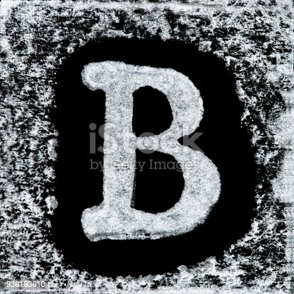 istock English capital letter 'B' printed white ink stamp isolated on black background. Cut out. 936193610