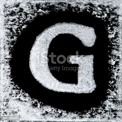 istock English capital letter 'G' printed white ink stamp isolated on black background. Cut out. 936193692