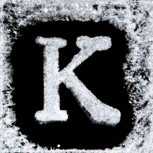 English capital letter 'K' printed white ink stamp isolated on black background. Cut out. English capital letter 'K' printed white ink stamp isolated on black background. Cut out. k icon stock pictures, royalty-free photos & images