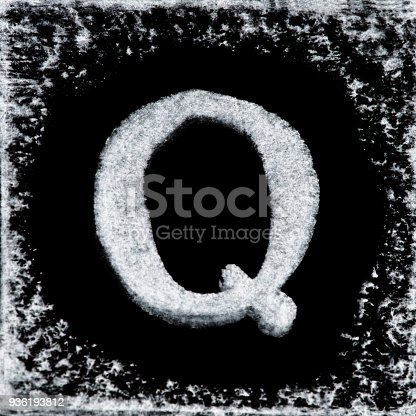 istock English capital letter 'Q' printed white ink stamp isolated on black background. Cut out. 936193812