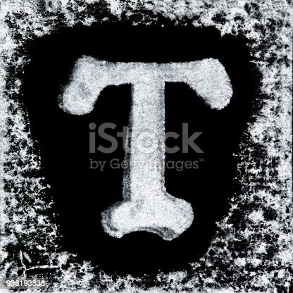 istock English capital letter 'T' printed white ink stamp isolated on black background. Cut out. 936193838