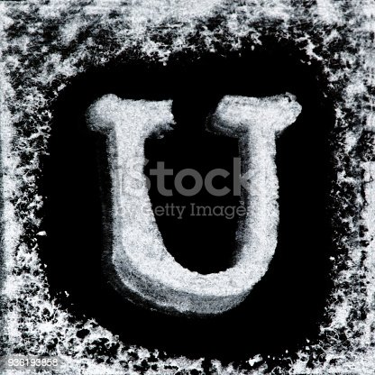 istock English capital letter 'U' printed white ink stamp isolated on black background. Cut out. 936193858