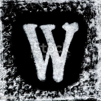 istock English capital letter 'W' printed white ink stamp isolated on black background. Cut out. 936193856
