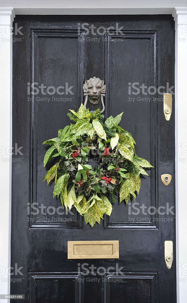 \'A victorian front door in London decorated at Christmas with a...