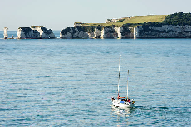 english coastline with chalk cliffs seen from a boat english coastline with chalk cliffs seen from a boat from Poole to cherbourg cherbourg stock pictures, royalty-free photos & images