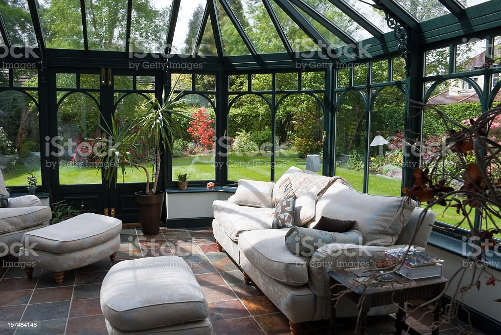 English Conservatory Sunroom with Modern Furniture stock photo