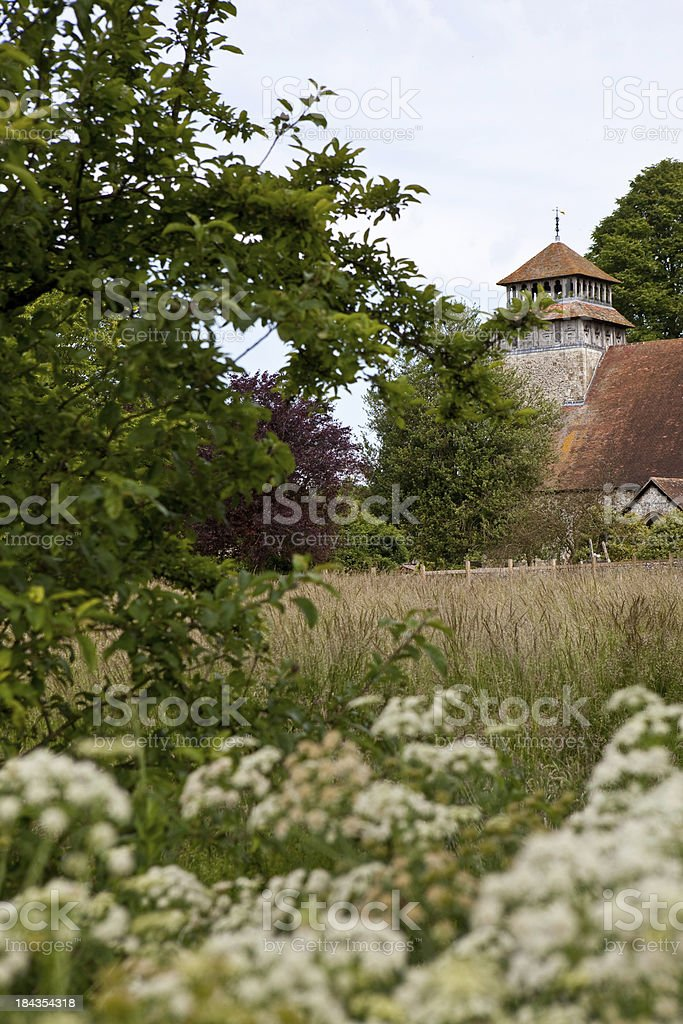 English Country Church in a meadow of white flowers stock photo